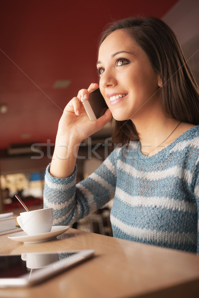 Happy woman having a phone call Stock photo © stokkete