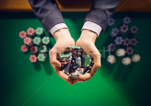 Casino playes holding a handful of chips Stock photo © stokkete