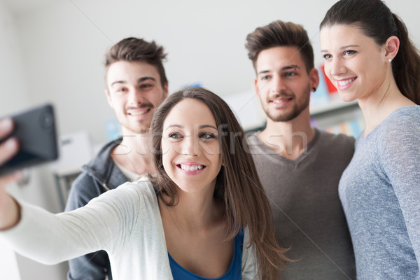 Teenagers taking selfies with a mobile phone Stock photo © stokkete