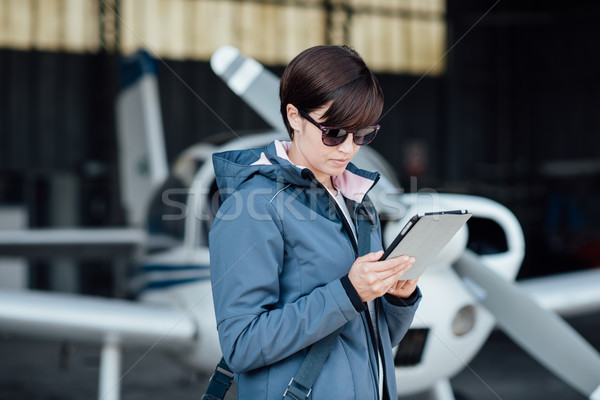 Pilot using aviation apps Stock photo © stokkete