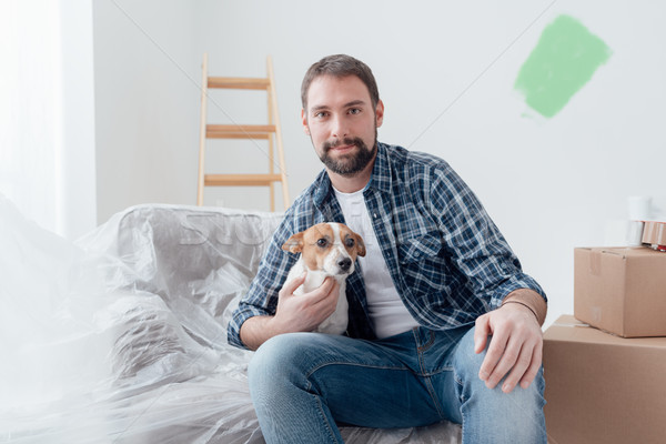 Dog owner in his new house Stock photo © stokkete