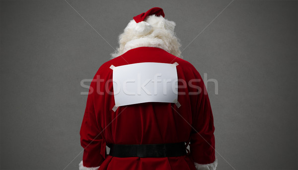 Santa Claus with a blank sign on his back Stock photo © stokkete