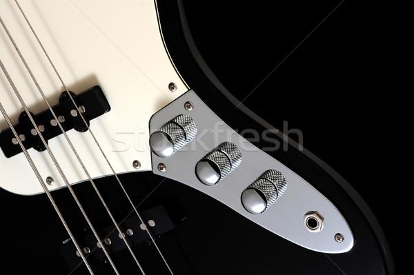 Közelkép fekete elektromos basszus fényes sötét Stock fotó © stokkete
