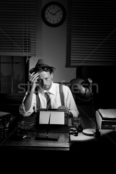 Reporter working late at night and smoking in his office Stock photo © stokkete