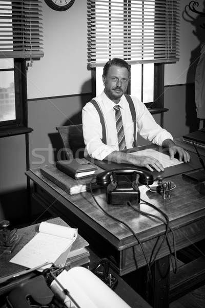 Confident businessman working at desk Stock photo © stokkete