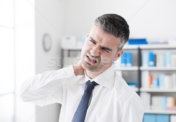 Nyaki fájdalom szomorú üzletember megérint nyak egészségügy Stock fotó © stokkete