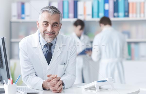 Médico recepción escritorio sonriendo médicos personal Foto stock © stokkete
