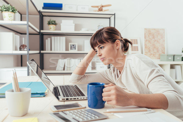 Tired woman at office desk Stock photo © stokkete