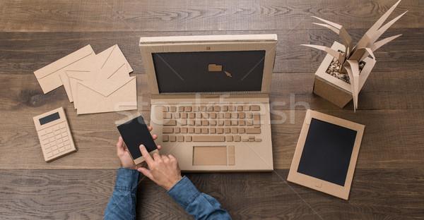 Creative картона служба бизнесмен рабочих используя ноутбук Сток-фото © stokkete