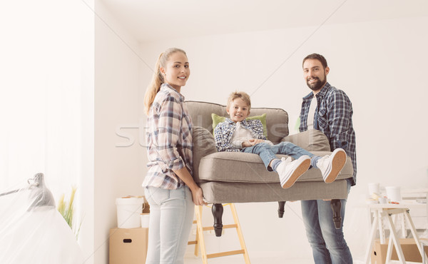 Family moving into a new home Stock photo © stokkete