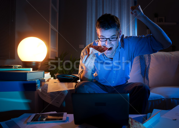Watching game on laptop Stock photo © stokkete