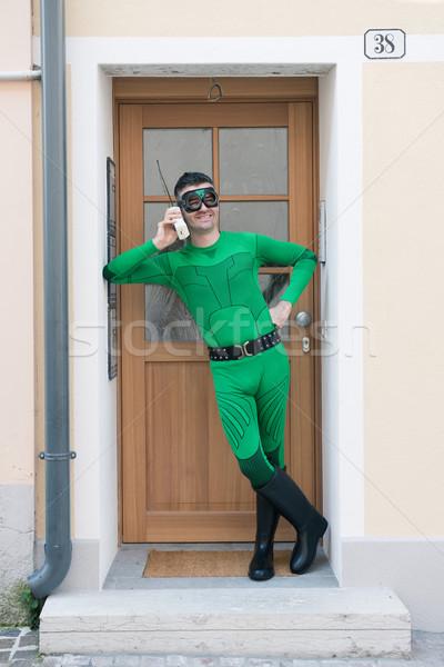 Cheerful superhero on the phone Stock photo © stokkete