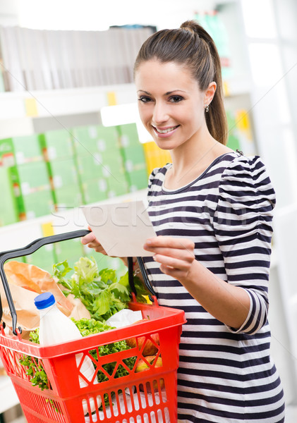 Woman with shopping list Stock photo © stokkete