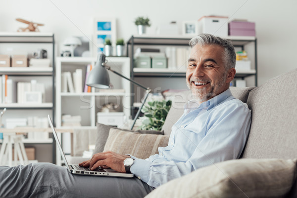 Cheerful businessman working at home Stock photo © stokkete