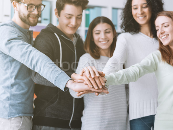 Stock photo: Young people stacking hands