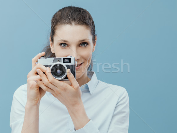 Photographer woman holding a camera and shooting Stock photo © stokkete