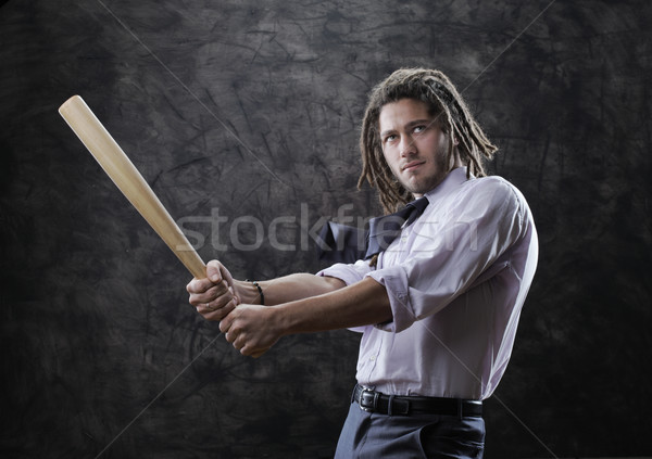 Businessman swinging baseball bat Stock photo © stokkete