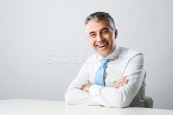 üzletember mosolyog portré jóképű érett férfi férfi Stock fotó © stokkete