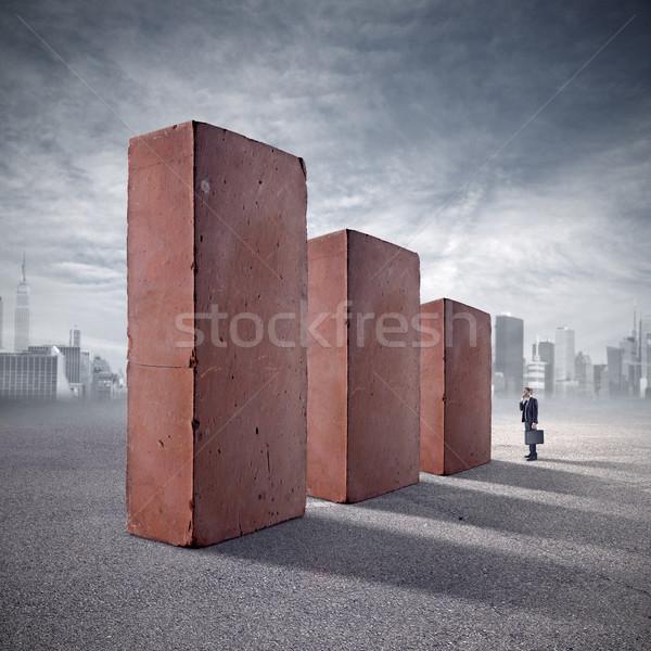 Befektetés téglák üzletember bámul hatalmas áll Stock fotó © stokkete