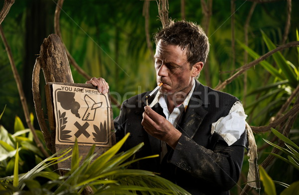 Businessman smoking in the jungle Stock photo © stokkete