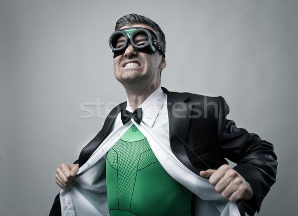 Superhero taking off shirt and jacket Stock photo © stokkete
