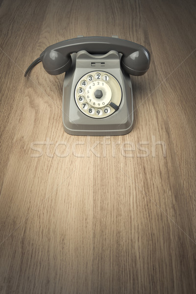 Vintage telephone on hardwood surface Stock photo © stokkete
