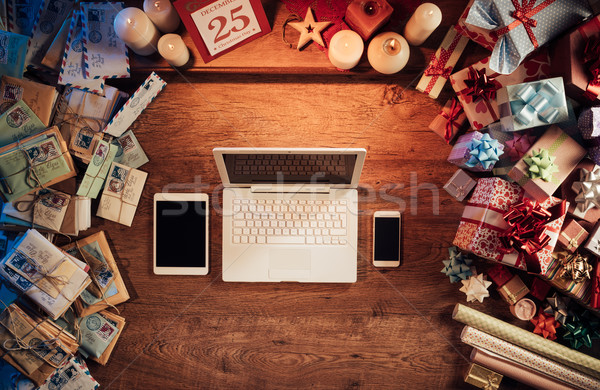 Christmas desktop with laptop and mobile devices Stock photo © stokkete