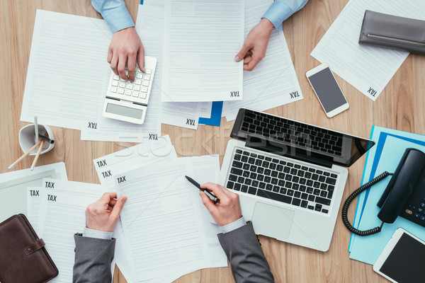 Business people checking tax forms Stock photo © stokkete