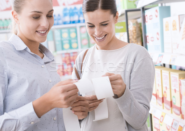 Women comparing their grocery receipts Stock photo © stokkete