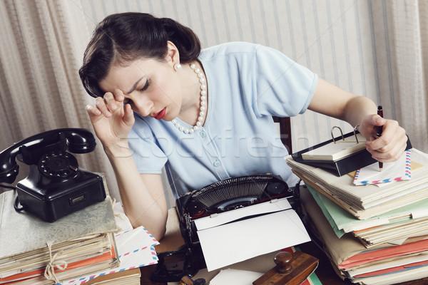 Stressz fáradt üzletasszony ül asztal tele Stock fotó © stokkete