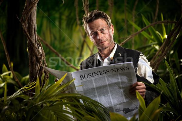 Biznesmen czytania finansowych wiadomości dżungli uśmiechnięty Zdjęcia stock © stokkete