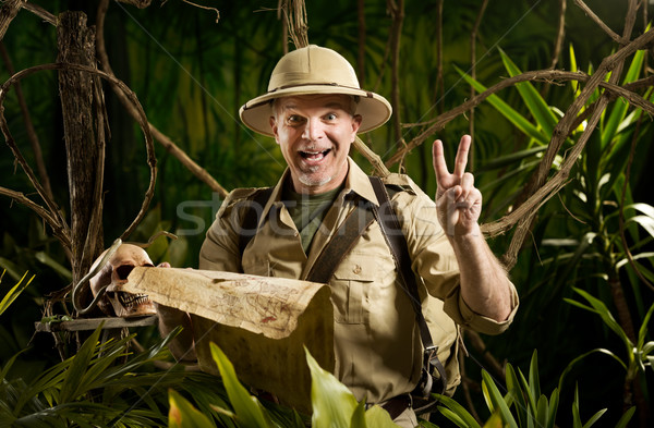 Stock photo: Successful adventurer in the jungle