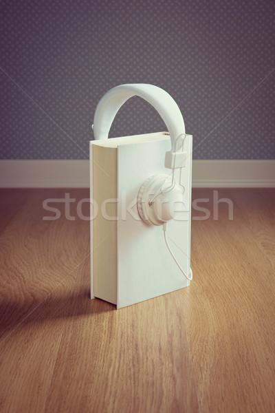 Book with white headphones Stock photo © stokkete