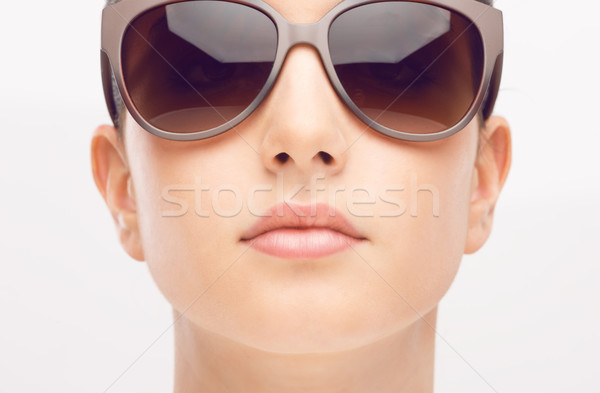 Young fashion model with sunglasses Stock photo © stokkete
