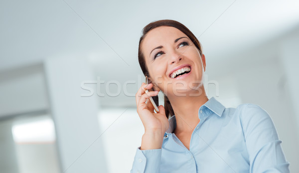 Smiling business woman having a phone call Stock fotó © stokkete
