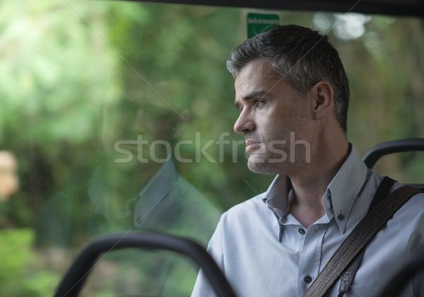 Pendulares trabalhar pensativo empresário sessão ônibus Foto stock © stokkete