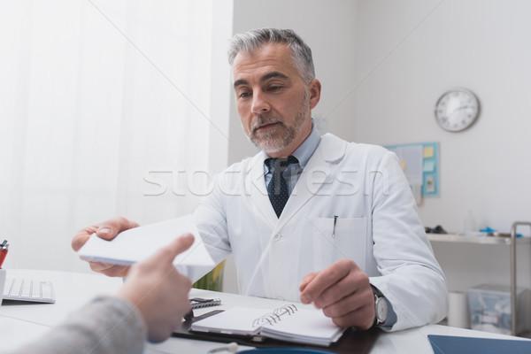 Doctor giving a prescription Stock photo © stokkete
