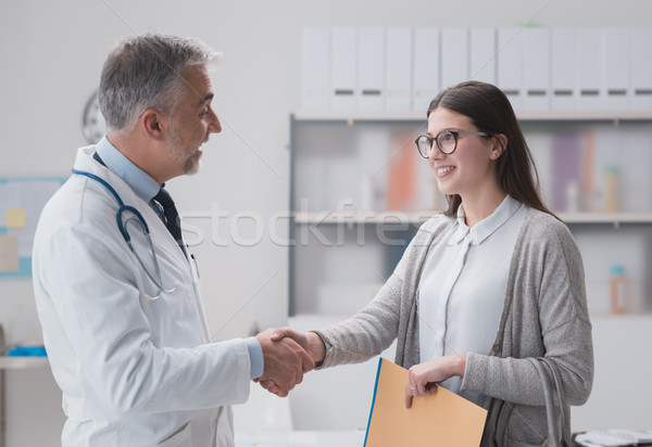 Doctor and patient shaking hands Stock photo © stokkete
