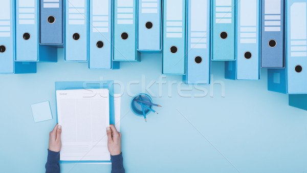 Office worker and archive binders Stock photo © stokkete