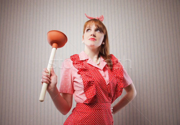 Housewife with plunger Stock photo © stokkete