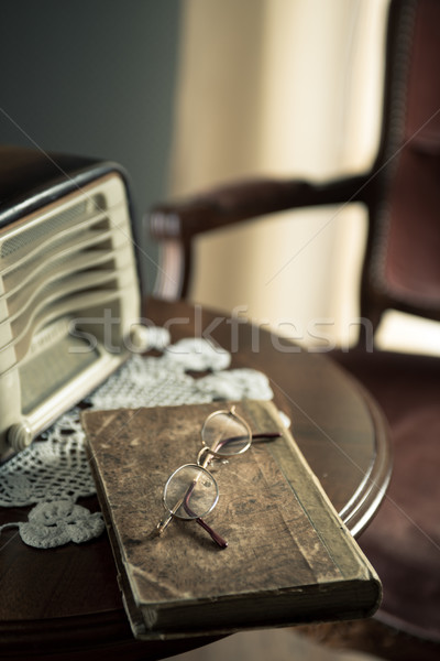 Vintage interior with old radio and book Stock photo © stokkete