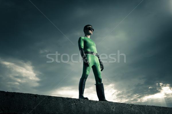 Superhero standing on a concrete wall Stock photo © stokkete