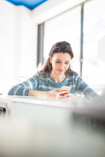 Cute girl texting with her mobile Stock photo © stokkete