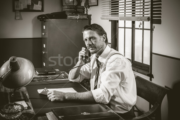 1950s office: director working on the phone Stock photo © stokkete