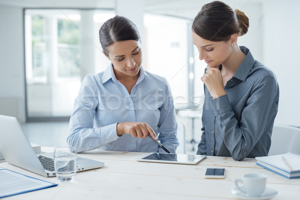 Business women working together on a tablet Stock photo © stokkete