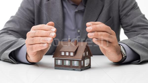 Ev sigortası planları işadamı model ev eller Stok fotoğraf © stokkete