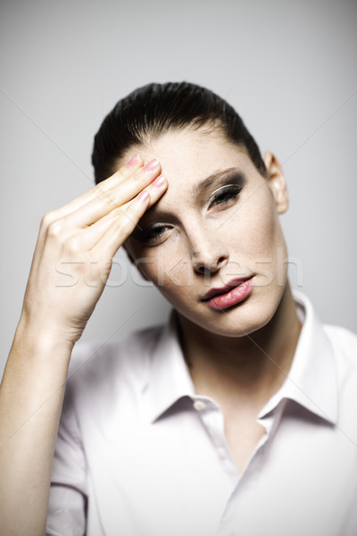 Beautiful woman having headache  Stock photo © stokkete
