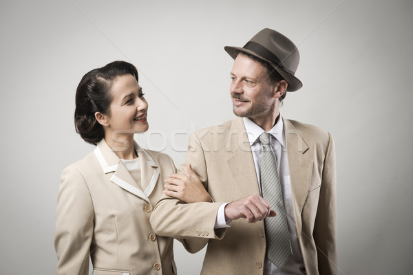 Elegant couple arm in arm Stock photo © stokkete
