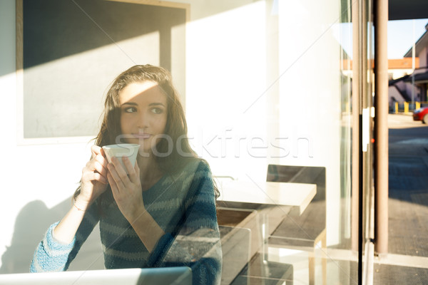 Beautiful girl having a coffee break at the bar Stock photo © stokkete