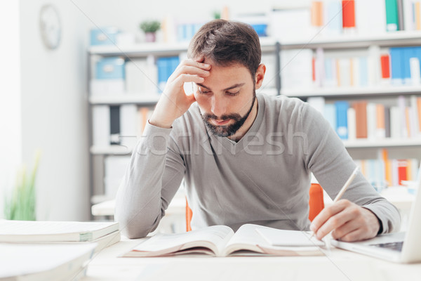 Man studying at the library Stock photo © stokkete